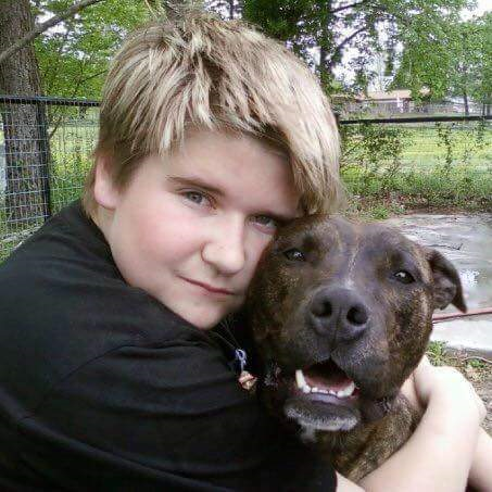 A photo of Caleb and his pitbull